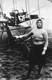 Hilda Hewlett beside a flyer